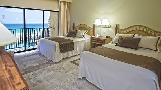 Ocean View Junior suite with double beds in Cancun beachfront resort